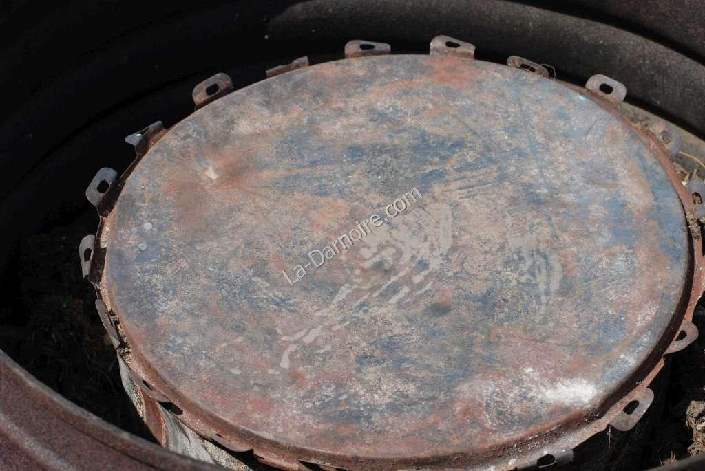 The charcoal retort; a smaller drum with a lid