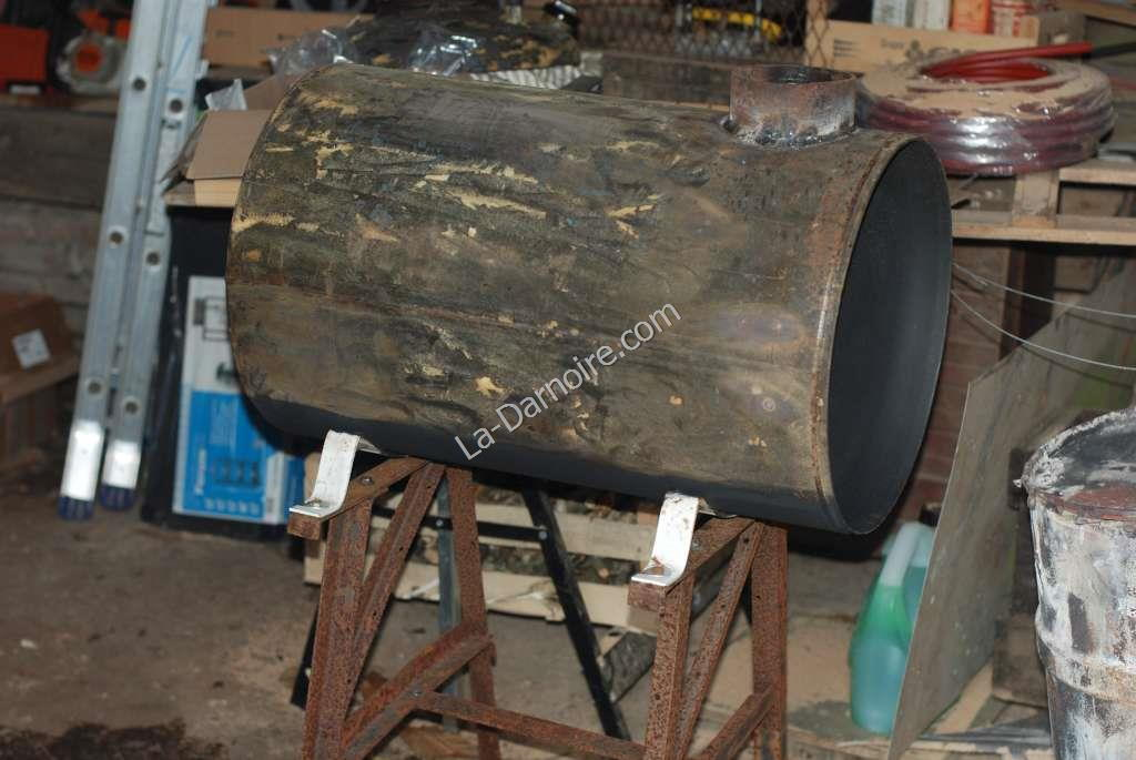 Woodstove being painted with high-temperature paint