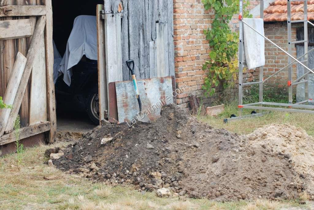The trench is excavated between the house and the borehole