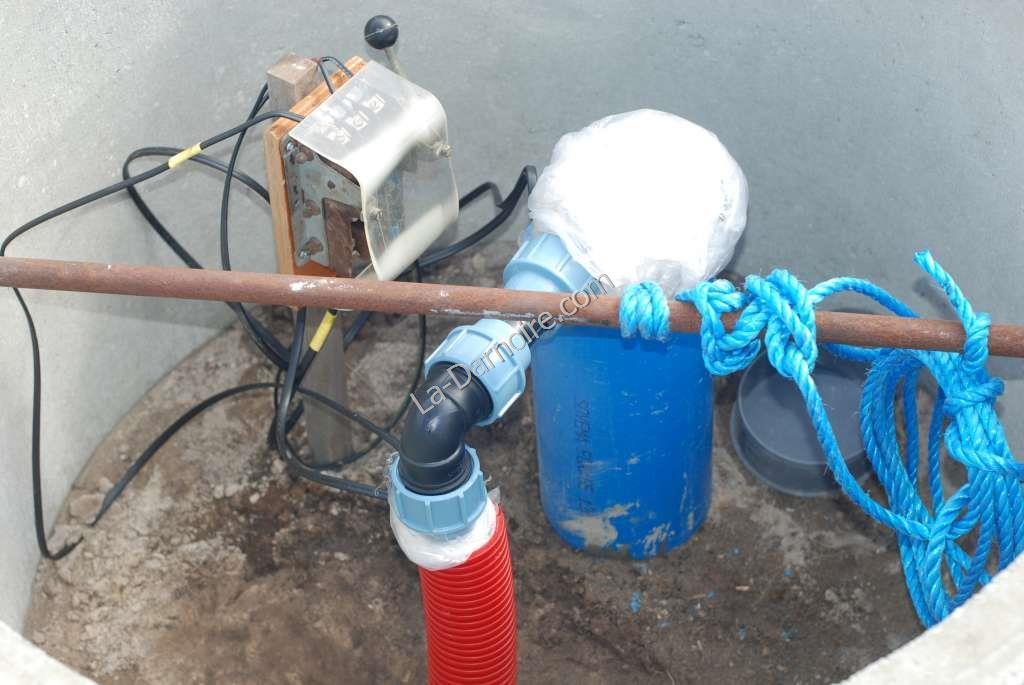 Pipe and cables connected up at borehole head